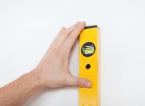 Как выровнять поверхность стен